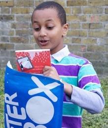 boy-with-letterbox-blue-parcel